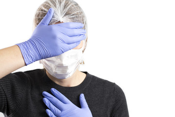 Anguished doctor covering her face with her hands