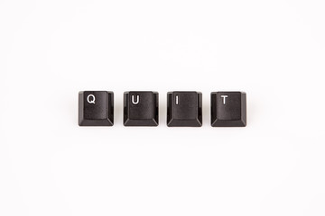 quit word written with black computer buttons over white
