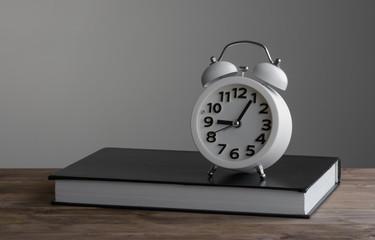 Alarm clock and book