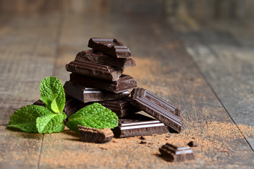 Stack of chocolate slices with mint leaf.