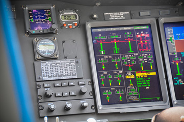 The pilots' control panel inside a passenger airplane