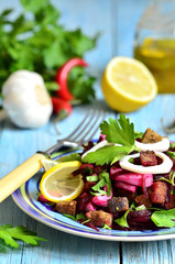 Beetroot salad with calamari and rye garlic croutons.