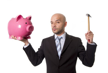 businessman with hammer  to break huge piggy bank