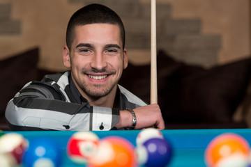 Smiling Happy Man Playing Billiard