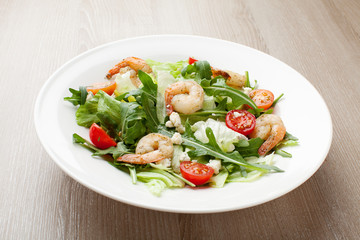 Fresh gourmet seafood salad with shrimps, greens, cherry tomatoe