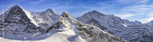 Fotobehang Alpen Four alpine peaks and skiing resort in swiss alps