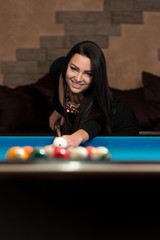 Smiling Happy Woman Playing Billiard
