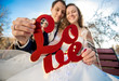 portrait of happy newlyweds holding Love word sign