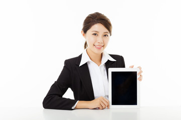smiling young businesswoman  showing  the tablet pc