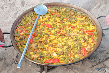 Traditional Spanish paella with human hands