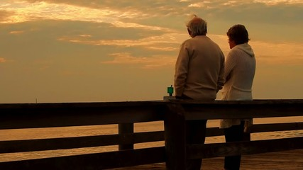 cute old couple watching the sunset together