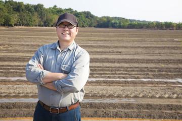 Farmer man standing on farming land