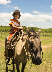 Child Riding Horse in a Farm