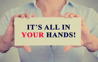 businesswoman hands holding card It's All in Your hands message