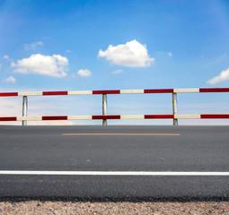 dangerous traffic fence beside asphalt road