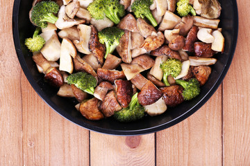 Braised wild mushrooms with vegetables and spices in pan