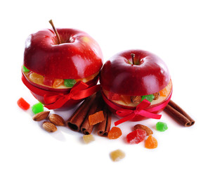 Red apples stuffed with dried fruits with cinnamon and almond