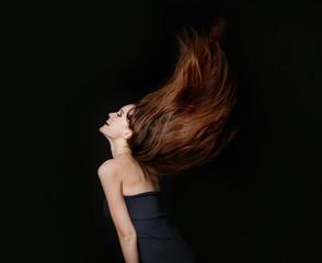 Beautiful dancing young woman with flowing long hair