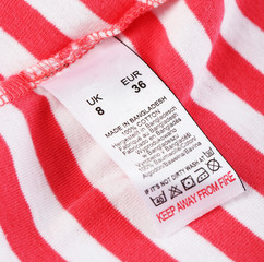 Label with laundry care symbols close-up on clothing