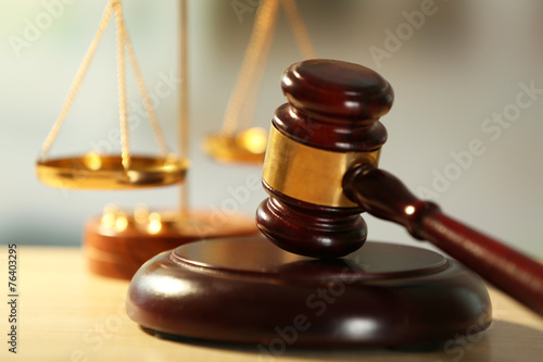 Wooden judges gavel on wooden table, close up - 76403295