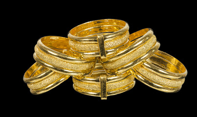 fancy golden rings isolated on black