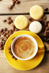 Gentle colorful macaroons and  coffee in mug