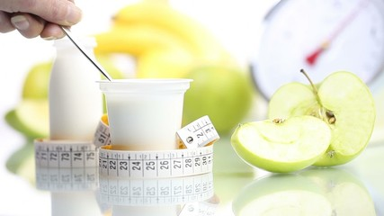 diet concept teaspoon blending yogurt fruit Apple meter and scal