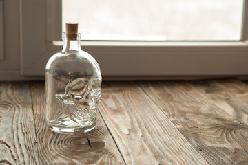 Bottle with a skull