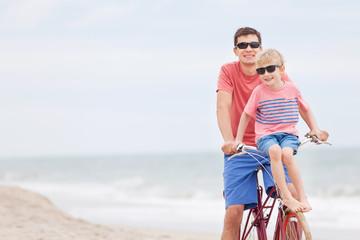 family biking at the beach
