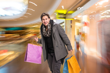 Smiling man with shopping bags