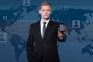 Businessman showing smartphone