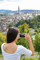 Tourist with smartphone camera in Bern Switzerland