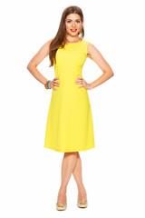 Fashion yellow dress. Smiling woman full body portrait white ba