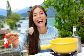 Swiss cheese fondue - woman eating laughing