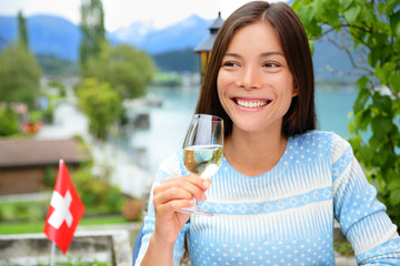 Woman drinking wine at dinner in Switzerland