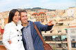 Romantic uban couple looking at view of Barcelona
