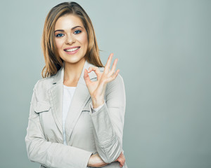 Business woman show ok symbol. Toothy smiling business woman