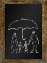 Concept of happy family in safety. Chalk drawing