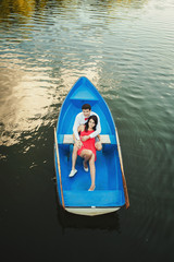 Lovers boating in a romantic place. Summertime