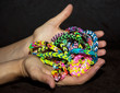 Female hands with colorful rubber bracelets