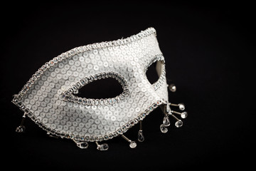 Silver ornate mask isolated on black