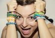 Crazy young woman with colorful rubber bracelets on her hands