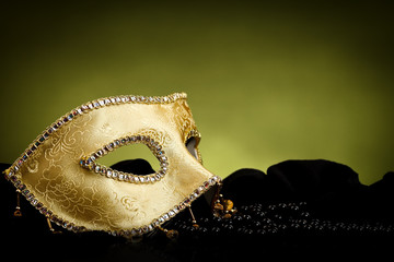 Golden mask over light background