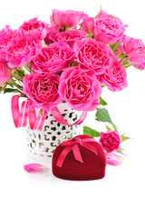 Bouquet of pink roses and Heart-shaped Gift Box on white