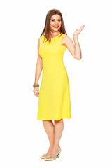 Full body portrait of smiling woman in yellow dress