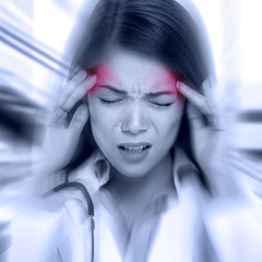 Young woman with a pounding headache