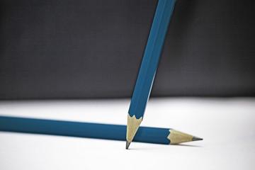 Green pencils on school board desk background