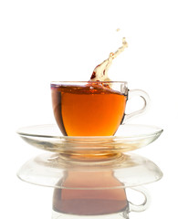 tea splash in a glass cup