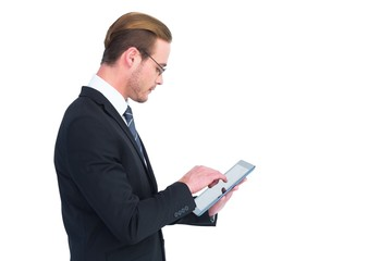 Businessman in reading glasses using his tablet pc