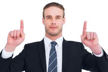 Serious businessman pointing up his fingers
